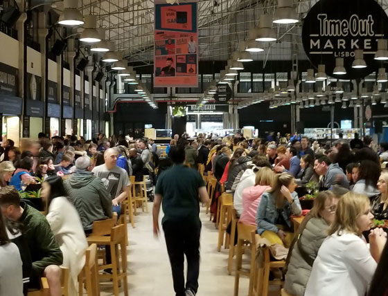 photo of person walking down the aisle at Time Out Market